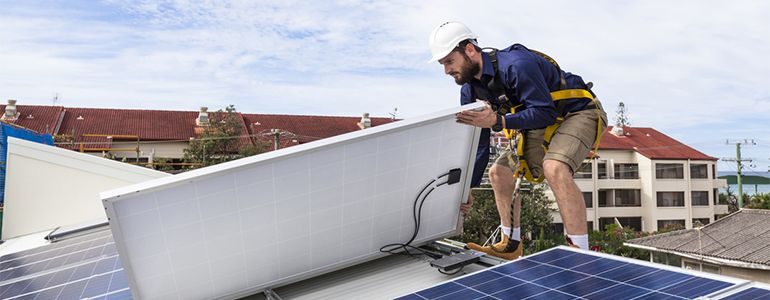 Man fitting solar panels